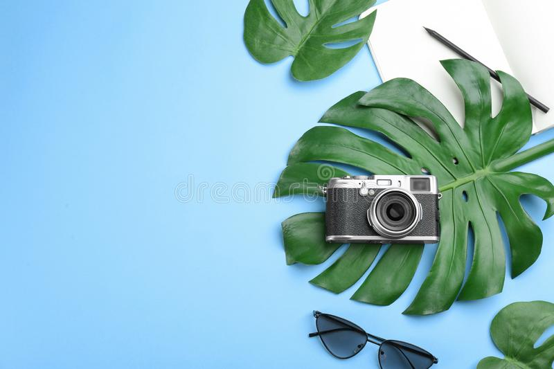 Flat lay composition with photographer camera on light blue background. Space for text. Flat lay composition with professional photographer camera on light blue stock photo