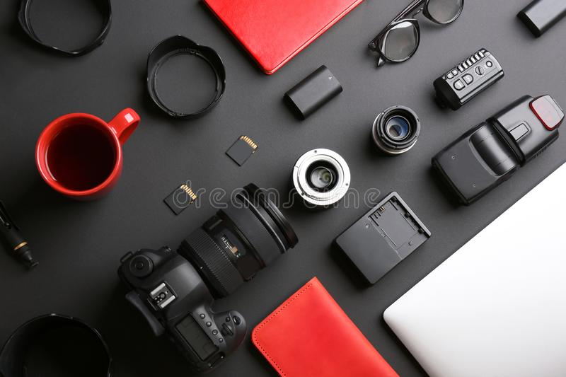 Flat lay composition with professional photographer equipment. On dark background stock image