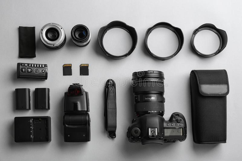 Flat lay composition with professional photographer. Equipment on light background stock photography