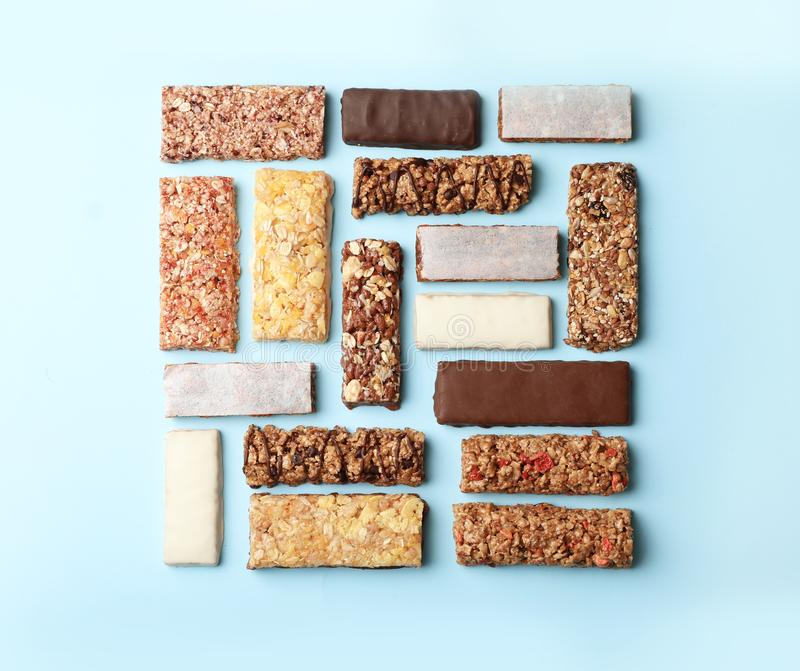 Flat lay composition with protein bars. On color background royalty free stock photography