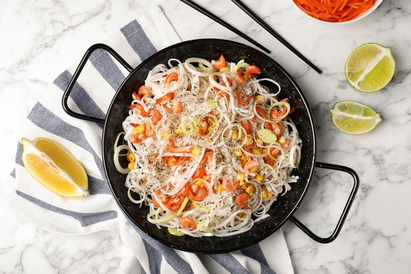 Flat lay composition with rice noodles in frying pan stock image