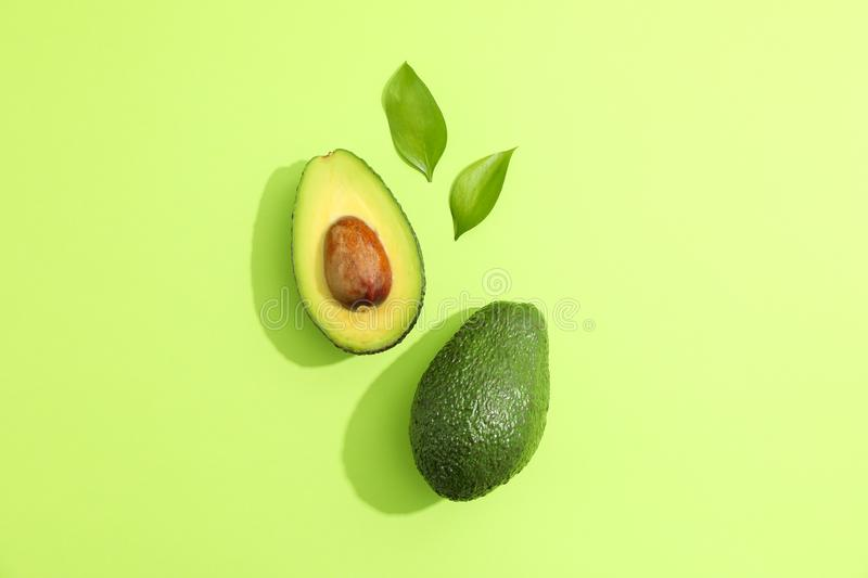 Flat lay composition with ripe avocados on white background, space for text stock image
