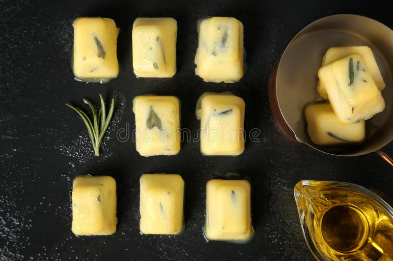 Flat lay composition with rosemary and olive oil ice cubes royalty free stock image