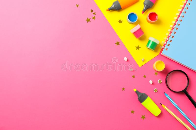 Flat lay composition with school supplies on two tone background. Space for text stock photo