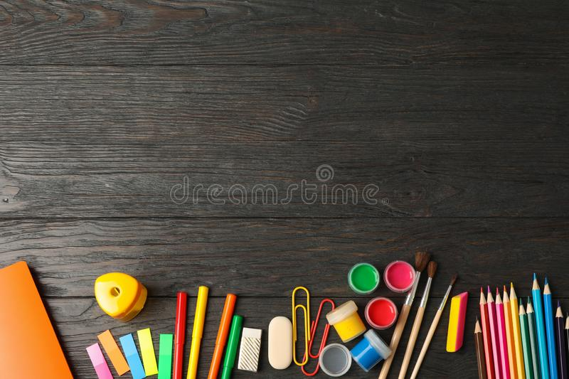 Flat lay composition with school supplies on wooden background. Space for text stock image