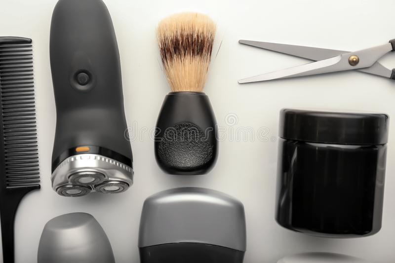 Flat lay composition with shaving accessories and cosmetics for men on white background royalty free stock photography