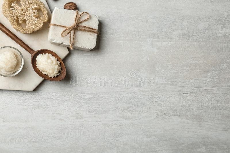 Flat lay composition with Shea butter and handmade soap on light background. Space for text royalty free stock photography
