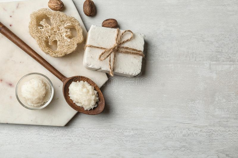 Flat lay composition with Shea butter and handmade soap on light background. Space for text royalty free stock image
