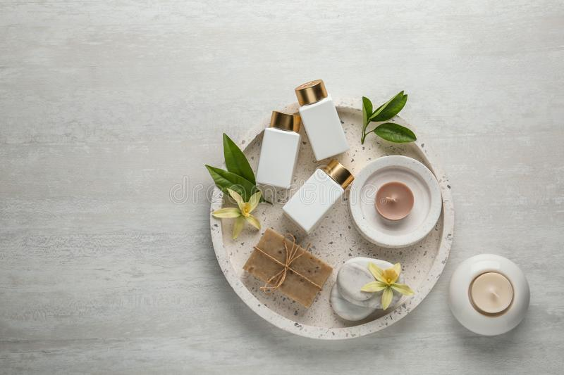 Flat lay composition with spa supplies. On wooden table royalty free stock images