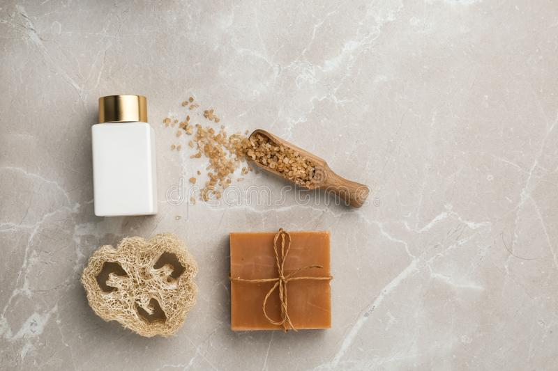 Flat lay composition with spa supplies on table. Flat lay composition with spa supplies on stone table royalty free stock photo