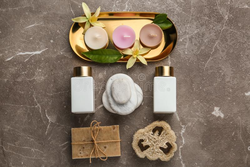 Flat lay composition with spa supplies on stone. Table royalty free stock photo