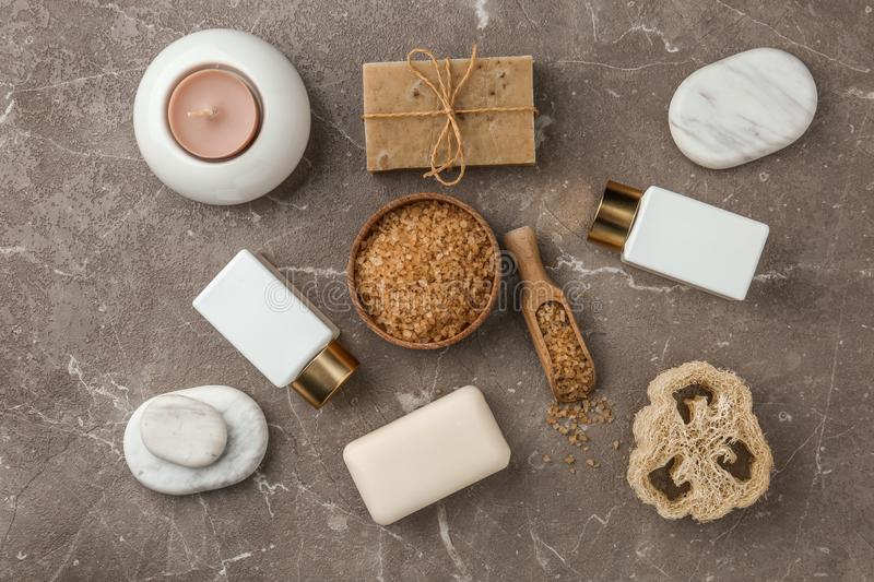 Flat lay composition with spa supplies on table. Flat lay composition with spa supplies on stone table stock photos