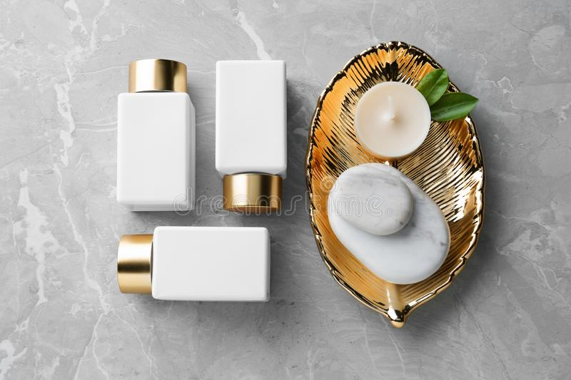 Flat lay composition with spa supplies. On stone table stock image