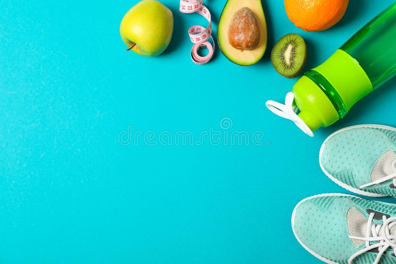Flat lay composition with sport lifestyle accessories. On color background stock image