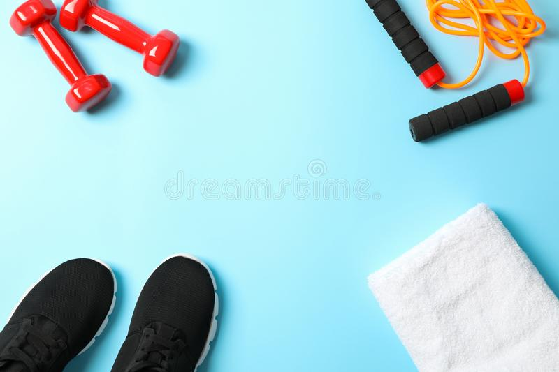 Flat lay composition with sport lifestyle accessories. On blue background royalty free stock photos