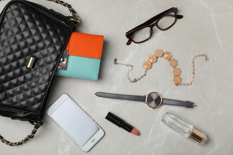 Flat lay composition with stylish bag. Wallet and accessories on light background stock photos