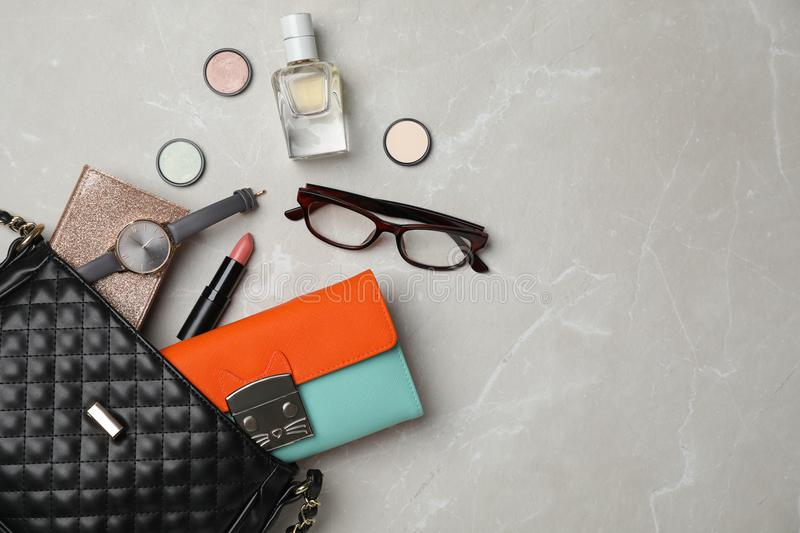 Flat lay composition with stylish bag, wallet. And accessories on light background stock photo
