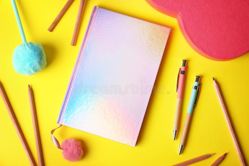 Flat lay composition with stylish female notebook and stationery. On color background royalty free stock photo