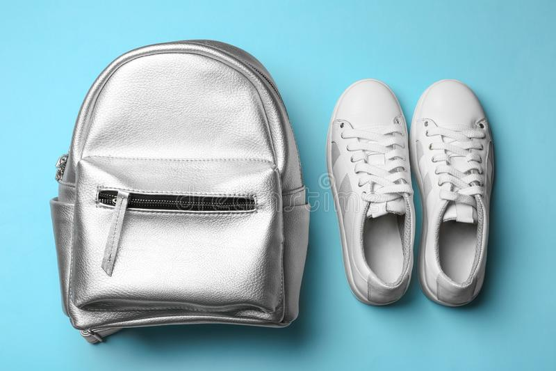 Flat lay composition of stylish shoes and backpack. On color background stock images