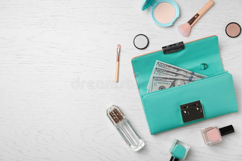 Flat lay composition with stylish wallet and accessories. On light background stock images