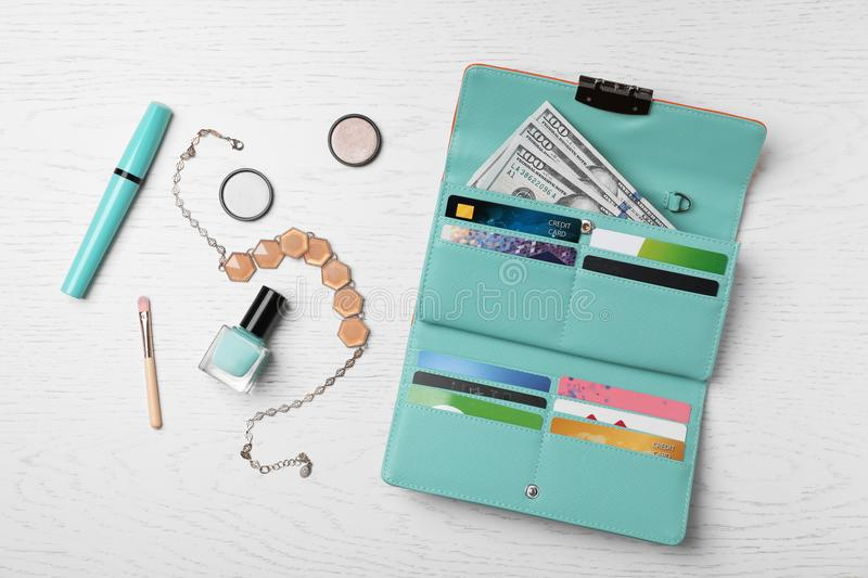 Flat lay composition with stylish wallet. And accessories on light background royalty free stock photo