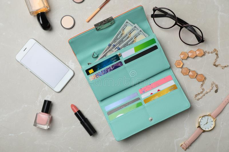 Flat lay composition with stylish wallet, smartphone. And accessories on light background royalty free stock photography