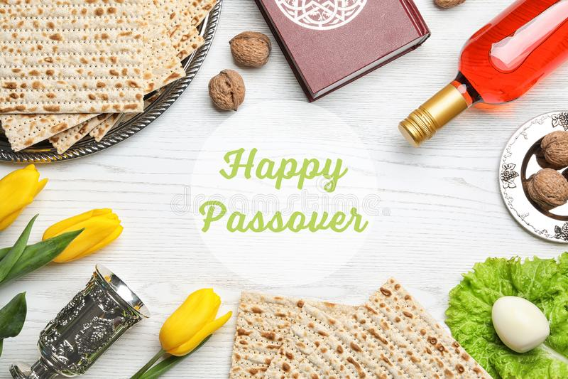 Flat lay composition with symbolic Passover Pesach items on wooden background. Space for text royalty free stock image