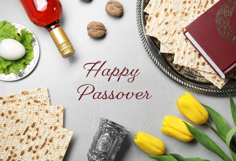Flat lay composition of symbolic Pesach items on light background. Happy Passover stock photos