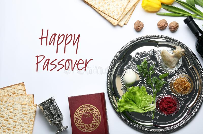 Flat lay composition of symbolic Pesach items on white. Happy Passover. Flat lay composition of symbolic Pesach items on white background. Happy Passover stock photo