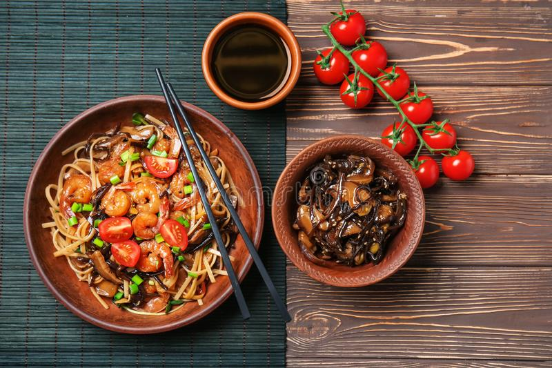Flat lay composition with tasty chinese noodles on wooden table royalty free stock image