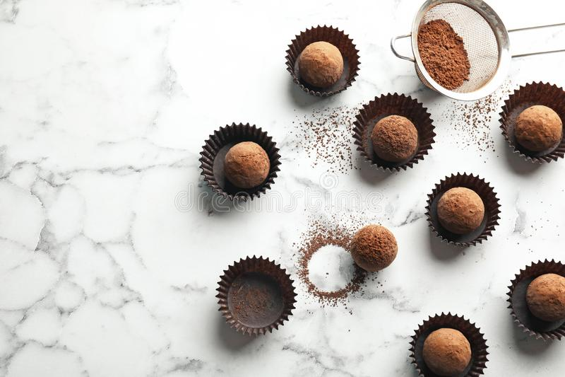 Flat lay composition with tasty raw chocolate truffles on marble background stock photo