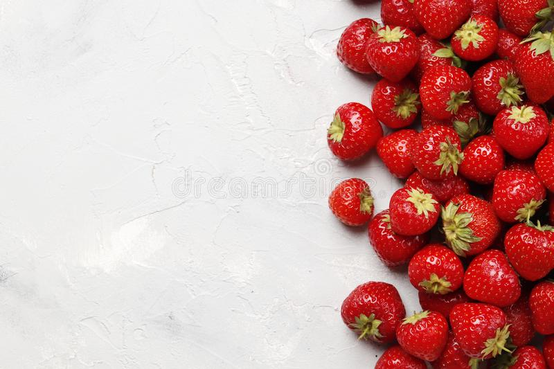 Flat lay composition with with tasty ripe strawberries on light background stock photo