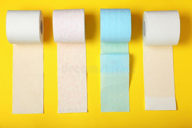 Flat lay composition with toilet paper. On color background royalty free stock images