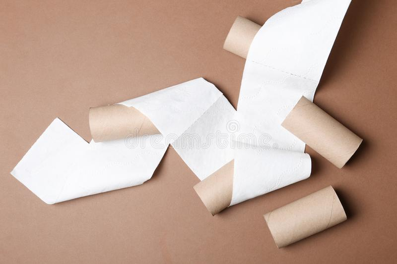Flat lay composition with toilet paper and empty rolls. On color background royalty free stock photography