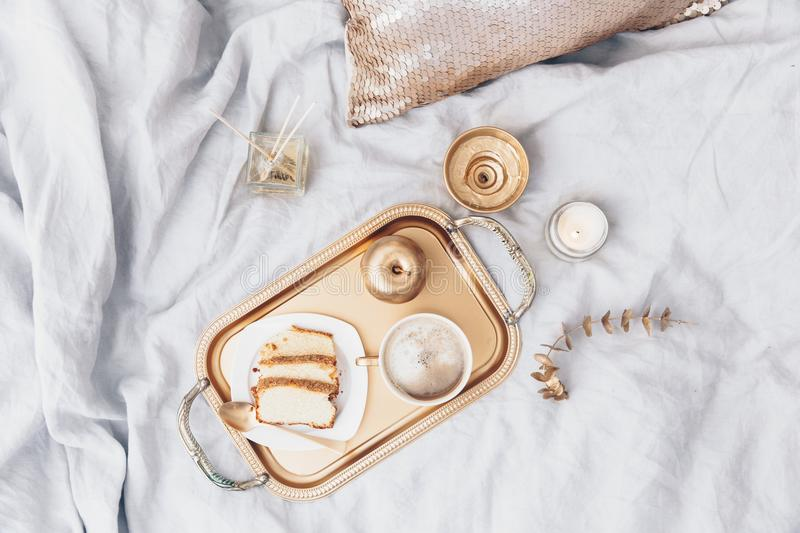 Flat lay composition with tray and breakfast in bed. stock photos