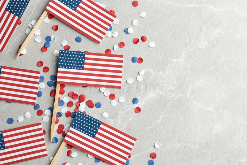 Flat lay composition with USA flags on light background. Happy Independence Day. Flat lay composition with USA flags on light background, space for text. Happy stock image