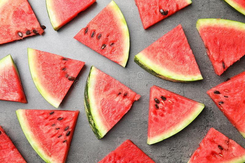 Flat lay composition with watermelon slices. On grey background stock image