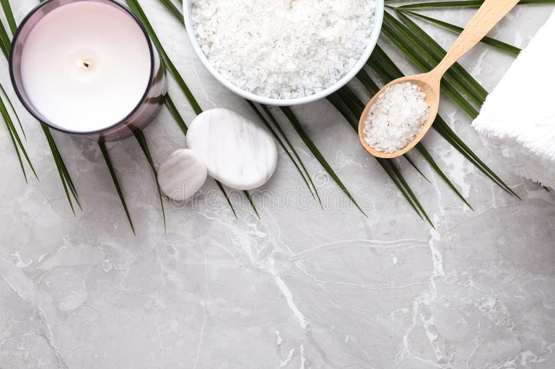 Flat lay composition with white sea salt on marble background. Spa treatment. Flat lay composition with white sea salt on marble background, space for text. Spa stock photography