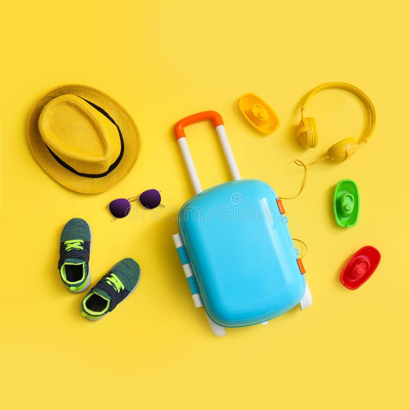 Free Flat Lay Composition With Blue Suitcase And Child Accessories On Background. Summer Vacation Royalty Free Stock Images - 162996299