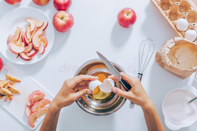Flat lay composition woman cooking batter for apple cake royalty free stock image