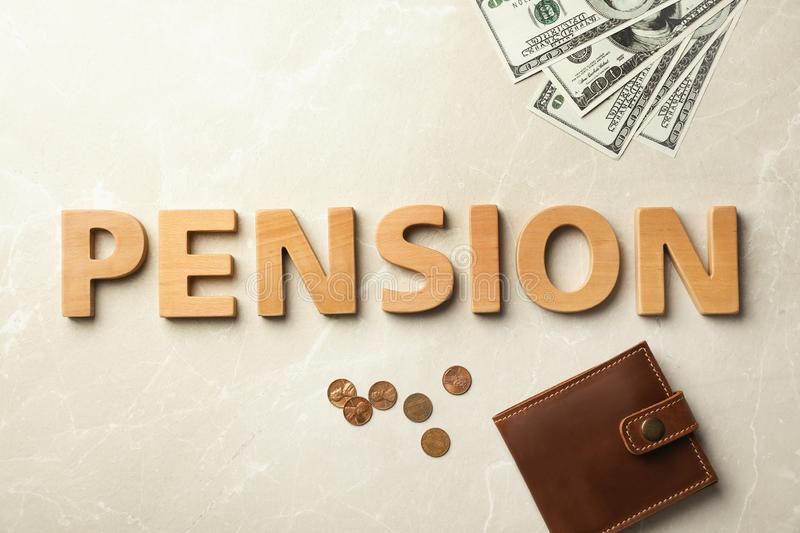 Flat lay composition with word. `PENSION `, wallet and money on gray background stock photography