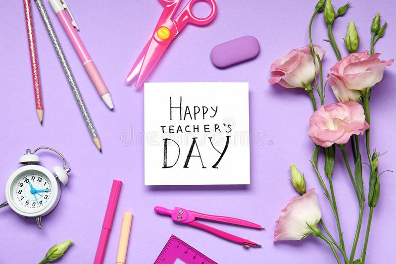 Flat lay composition with words HAPPY TEACHER`S DAY, stationery and flowers stock photography