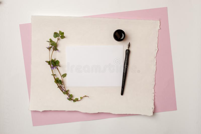 Flat lay composition, workspace with quote follow your heart written in calligraphy style on white paper. Artist working place, we stock photography