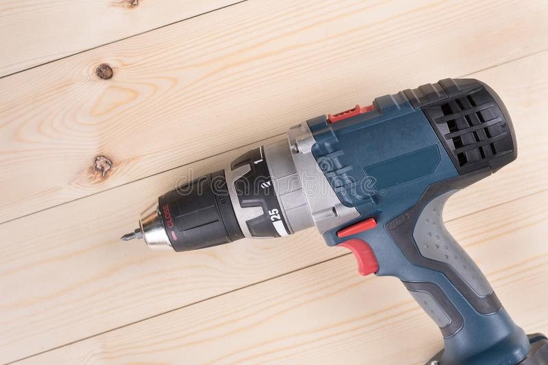 Flat lay cordless drill on the wooden boards with copy space stock photos