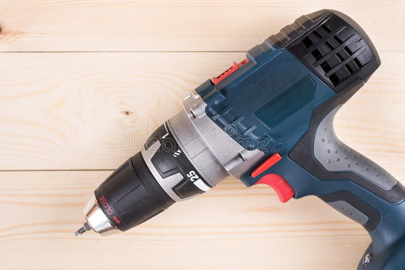 Flat lay cordless drill on the wooden boards with copy space stock images