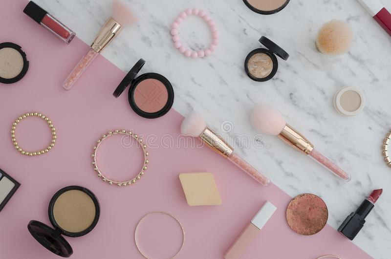 Flat lay Cosmetics for makeup, eye shadow, brush, highlighter, concealer, makeup, lipstick, mascara, blush marble and royalty free stock photo