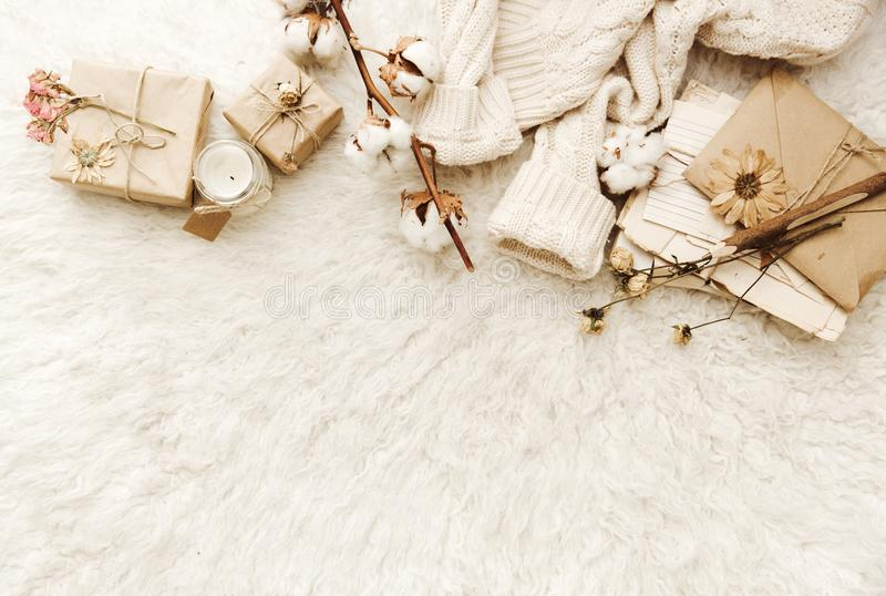Flat lay cozy composition. Trendy autumn background with dried cotton stock photo