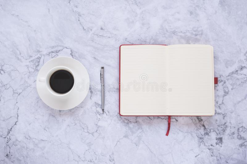 Flat lay creative and designer background with cup of coffee and office tools on white marble background stock photography