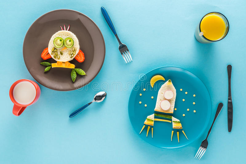 Flat lay with creatively styled children`s breakfast with drinks royalty free stock image