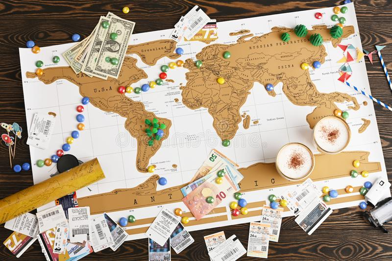 Flat lay design of travel concept. Traveler objects on the world map background. Tourists essentials stock image